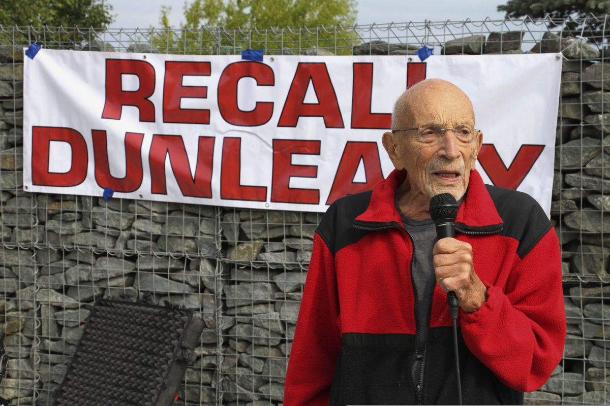 Vic Fischer, the last living member of the group of 55 men and women who wrote Alaska's state constitution, addresses a crowd gathered Thursday, Aug. 1, 2019, in Anchorage, Alaska, to sign petitions to recall Alaska Gov. Mike Dunleavy. Dunleavy angered many in the last few weeks with budget vetoes of more than $400 million. (AP Photo/Mark Thiessen)