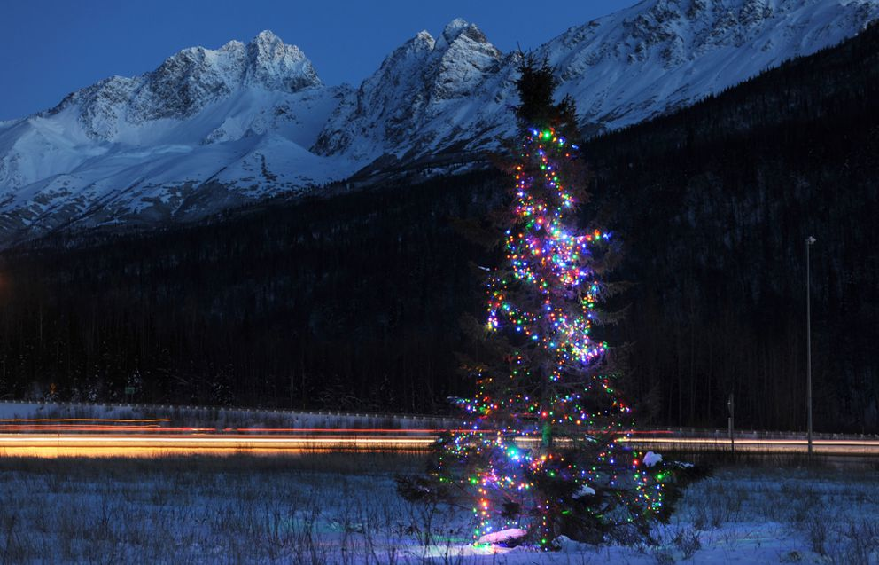 The previous Christmas tree with battery-powered lights greets motorists as they travel along the Glenn Highway near the Old Glenn overpass on Dec. 23, 2013. (Bill Roth / ADN archive)
