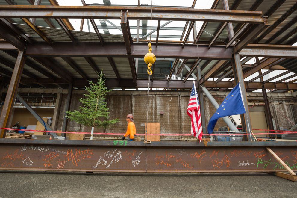 Signatures from construction workers and others adorn the last steel beam to be placed atop the Anchorage Museum's new $24 million expansion on Wednesday. (Loren Holmes / Alaska Dispatch News)