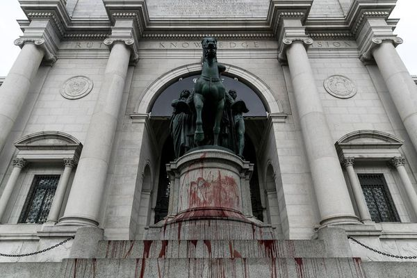 The Theodore Roosevelt statue outside the American Museum of Natural History after it was splashed with red paint. (Jeenah Moon for The New York Times)