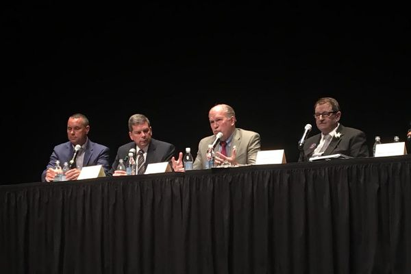 Candidates for Alaska's governor converge on downtown Anchorage Thursday for a forum. From left to right: Dr. Gary Ferguson, the moderator, and candidates: Mark Begich, Gov. Bill Walker and Billy Toien. (Tegan Hanlon ADN)