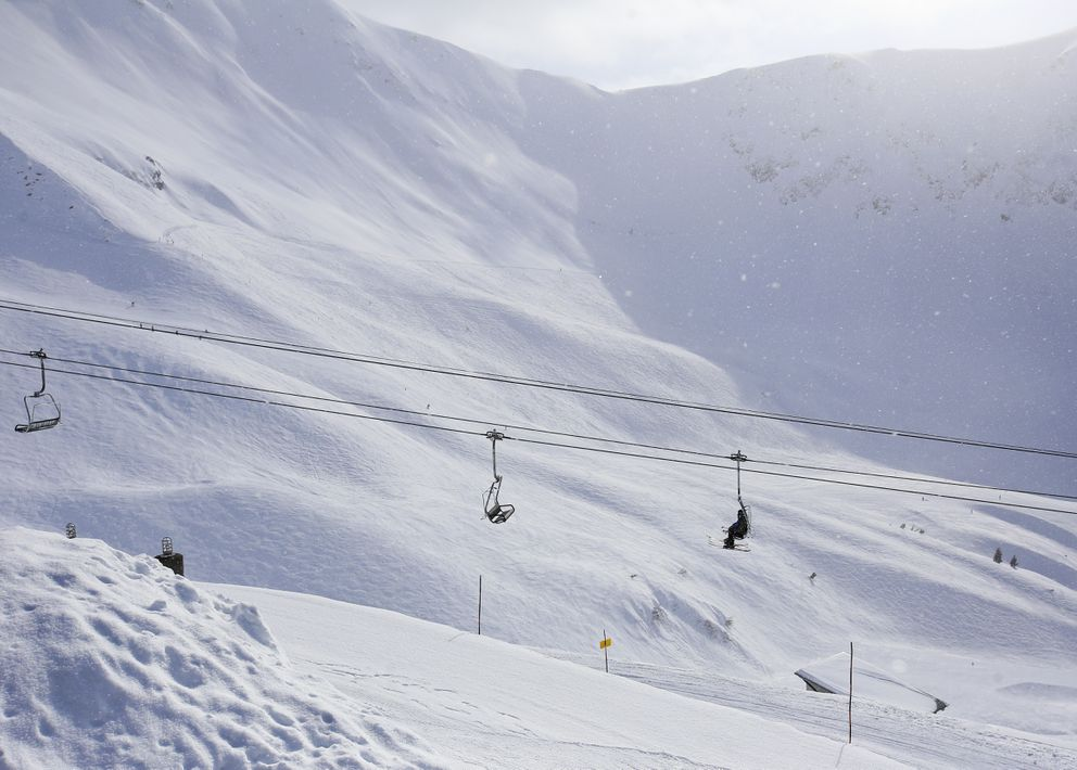 Light snow falls as skiers ride Chair 6 — the Glacier Bowl Express lift — up the mountain at Alyeska Resort in Girdwood on Tuesday, March 23, 2021. (Emily Mesner / ADN)
