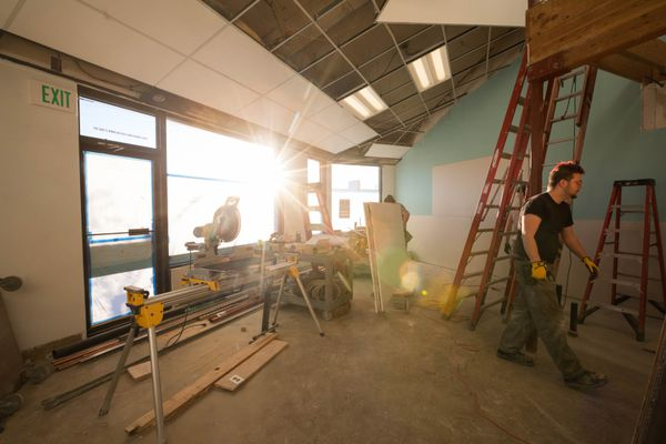 People work on renovations at the Chicken Shack, a new restaurant in Spenard, on Tuesday, Jan. 9, 2018. (Loren Holmes / ADN)