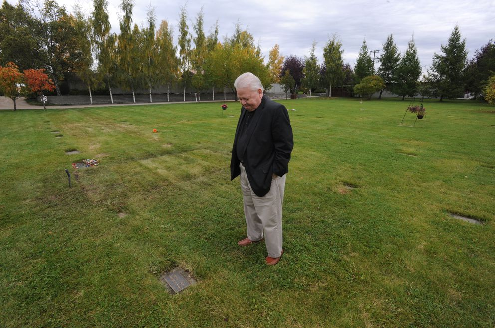 Kris Anderson visits the gravesite of his good friend and former North Slope co-worker Felix Delgado who rests at Anchorage Memorial Park Cemetery last Wednesday.  (Bill Roth / Alaska Dispatch News)