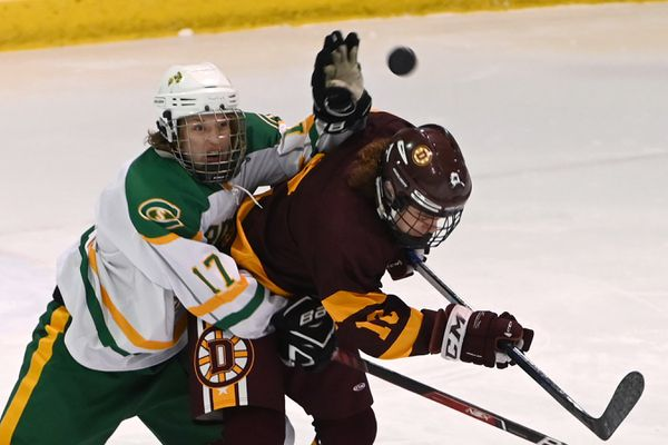 Service's Oscar Clay and Dimond's Max Hickel battle for the puck during first period action at Ben Boeke on Wednesday, Jan. 22, 2020. (Bill Roth / ADN)