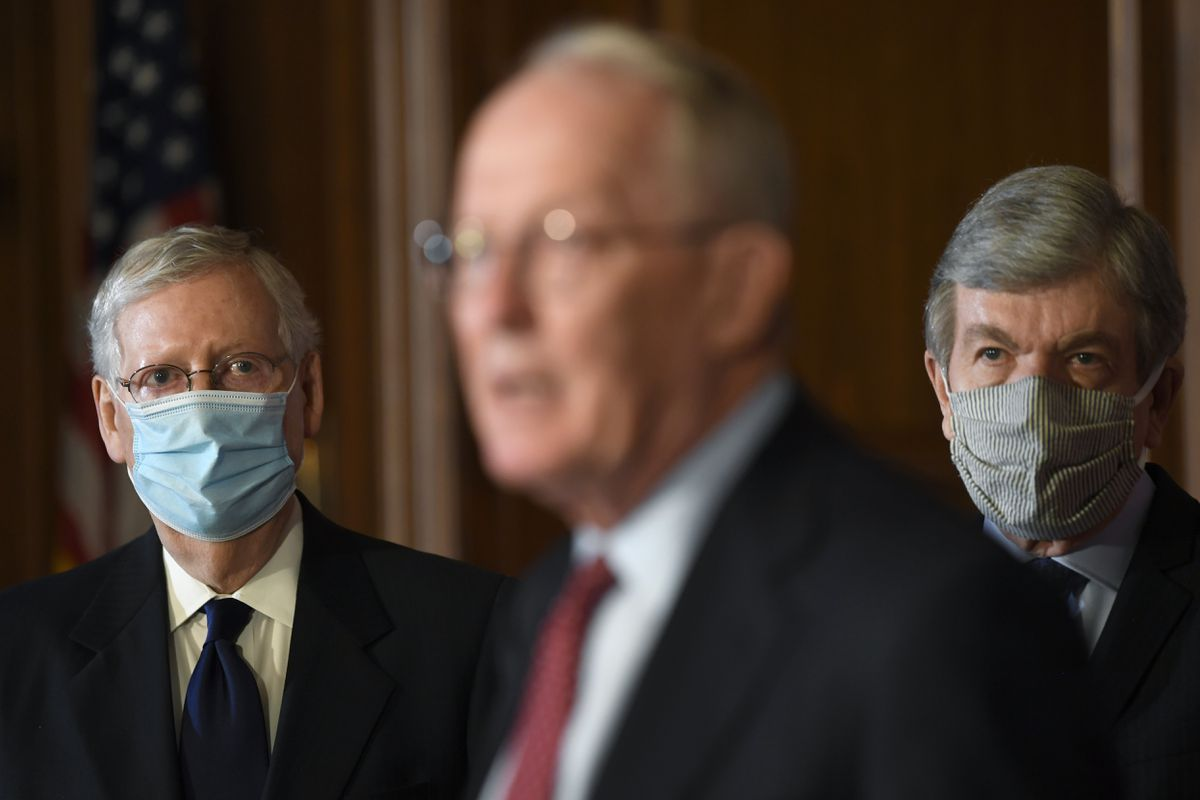 Senate Majority Leader Mitch McConnell of Ky., left, and Sen. Roy Blunt, R-Mo., right, listen as Sen. Lamar Alexander, R-Tenn., center, speaks during a news conference on on Capitol Hill in Washington, Monday, July 27, 2020, to highlight the new Republican coronavirus aid package. (AP Photo/Susan Walsh)