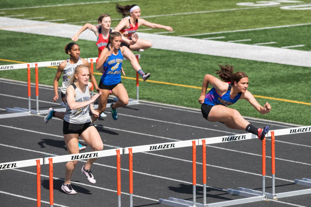 Kodiak's Hallee Blair clears a hurdle during the 100 meter hurdles race at the Brian Young Invitational Friday, May 31, 2019 at West High. (Loren Holmes / ADN)