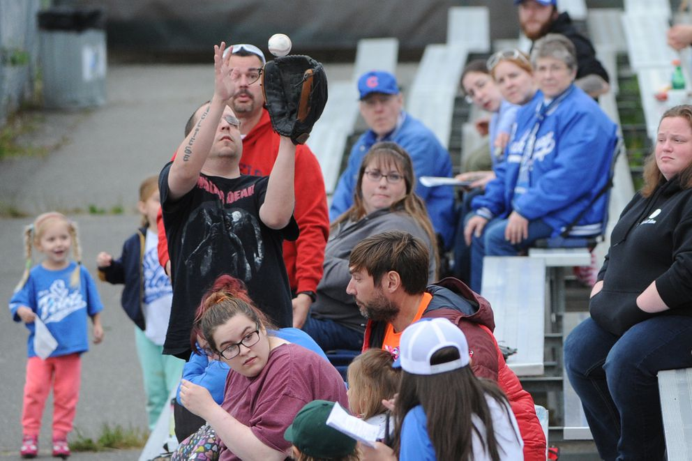 A fan catches a foul ball durings a Bucs-Pilots game last year. (Bill Roth / ADN archives)
