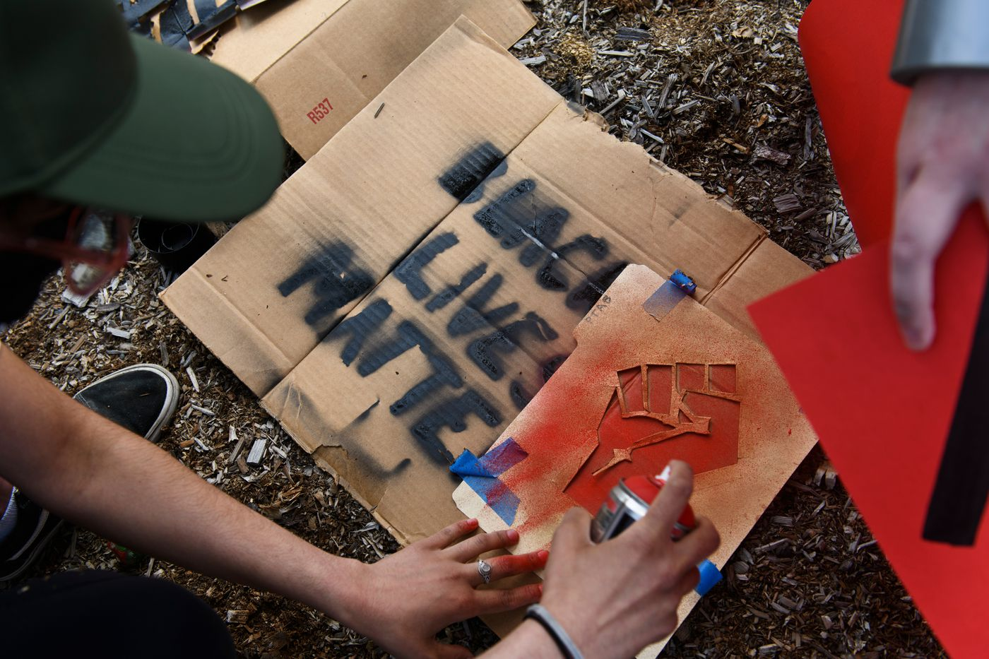 A sign is painted at the start of the Midtown rally. (Marc Lester / Anchorage Daily News)