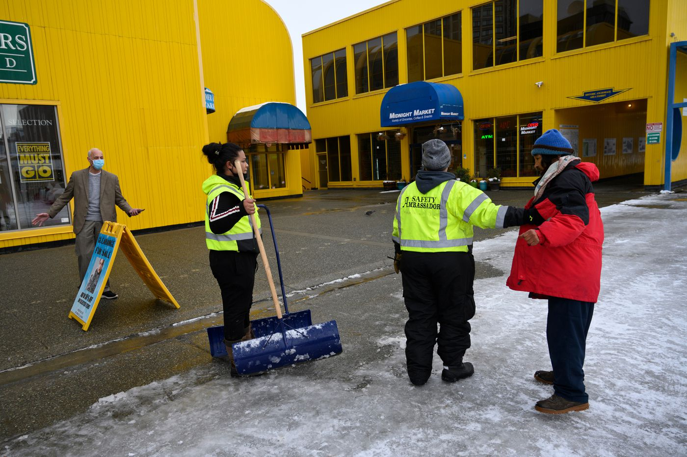 Adam Glazer of Wild Furs Limited, left, confronts a man in front of the business who threatened to spit at him before Safety Ambassadors intervened. (Marc Lester / ADN)
