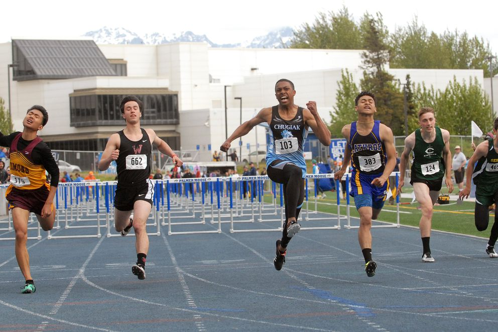 Chugiak's Logan Mathieu (103) exclaims as he wins the Division I boys 110 meter hurdles race at the ASAA/First National Bank Alaska Division I Track and Field Championships at Machetanz Field in Palmer on Saturday, May 25, 2019. (Matt Tunseth / Chugiak-Eagle River Star)