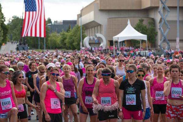 Participants line up before the start of the Alaska Run For Women Saturday, June 8, 2019 in Anchorage. Over 4,000 women participated in the run, which includes timed and untimed 5-mile runs and a 1-mile walk. (Loren Holmes / ADN)
