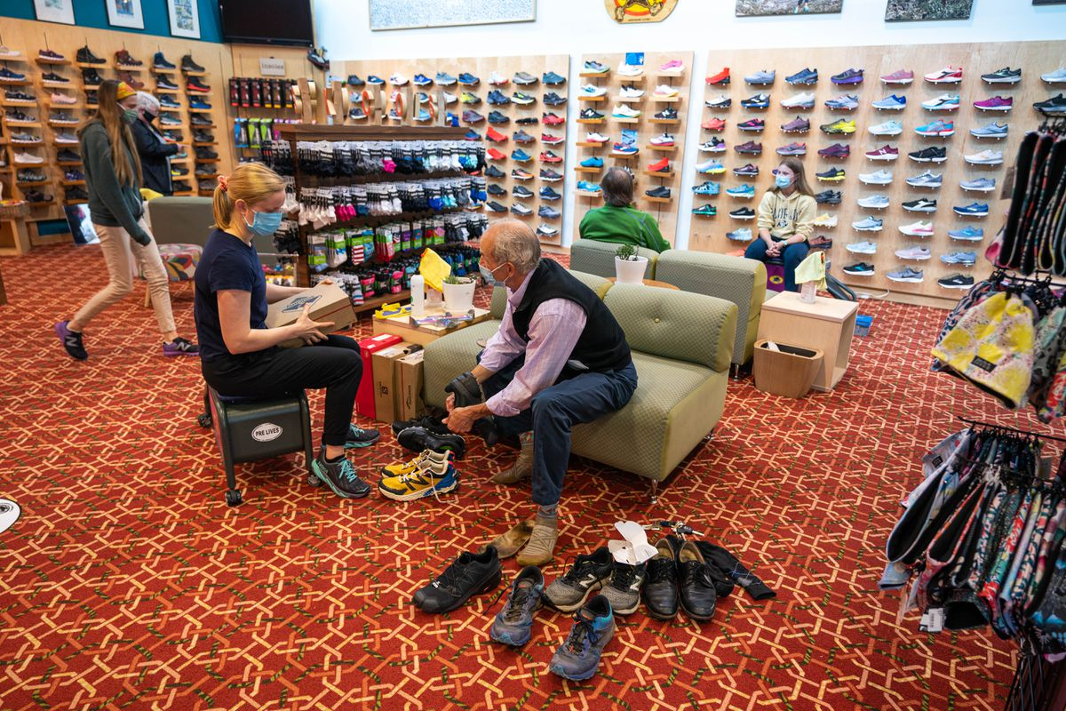 Jen Yach helps customer Dennis Poirier at Skinny Raven on Friday, June 19, 2020 in downtown Anchorage. (Loren Holmes / ADN)