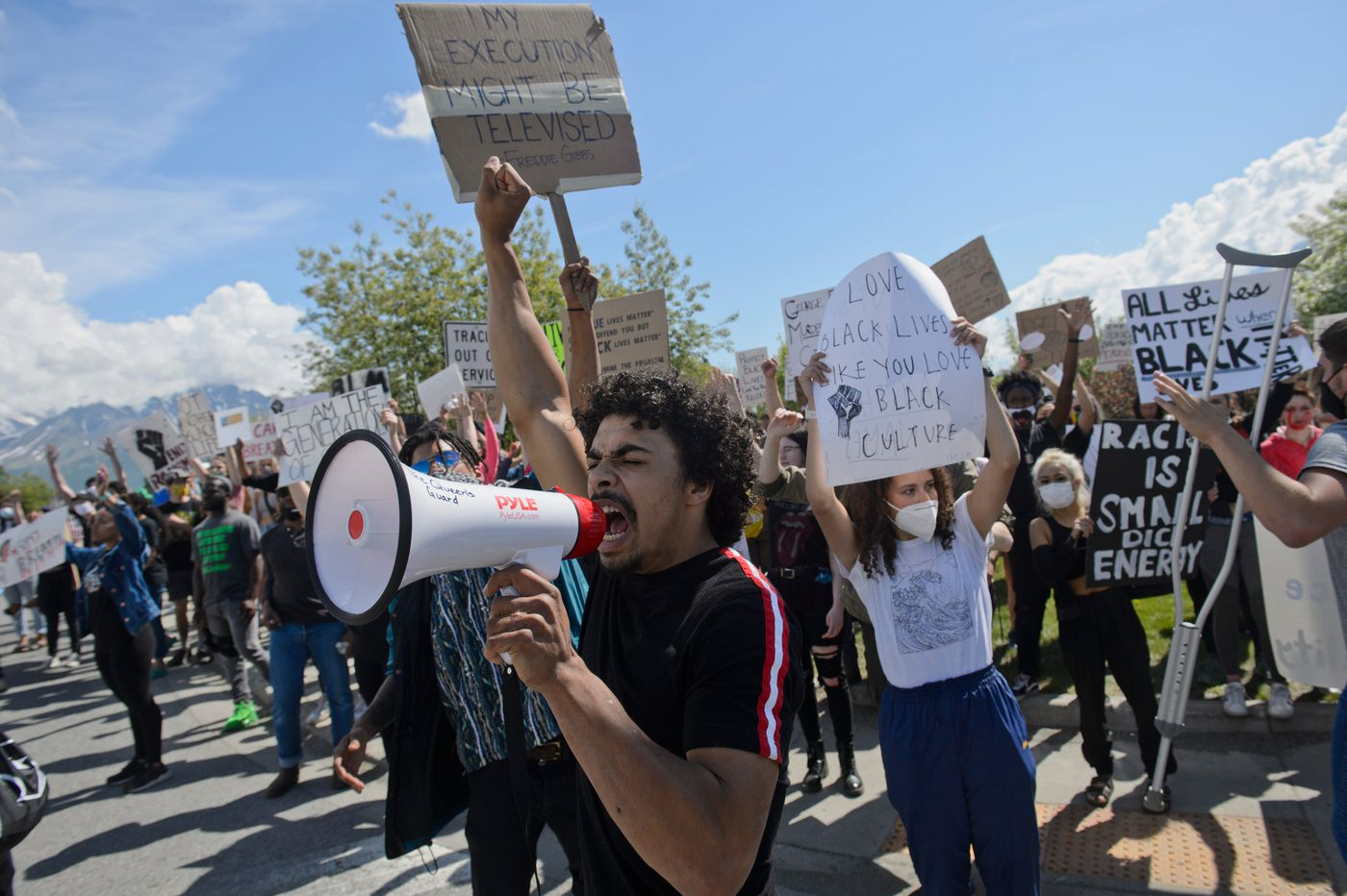 Justin Brotherwood leads a chant. A large crowd gathered and marched through Palmer to protest racism and police brutality on Saturday, June 6, 2020. (Marc Lester / ADN)