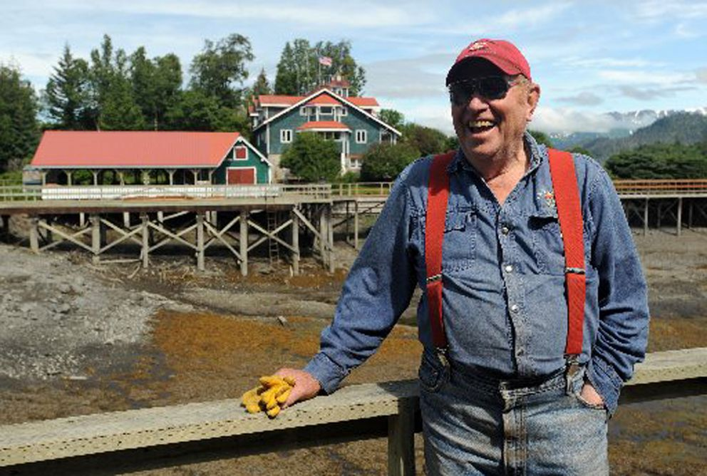Clem Tillion, with his Halibut Cove home in the background. (Erik HIll / ADN archive 2010)