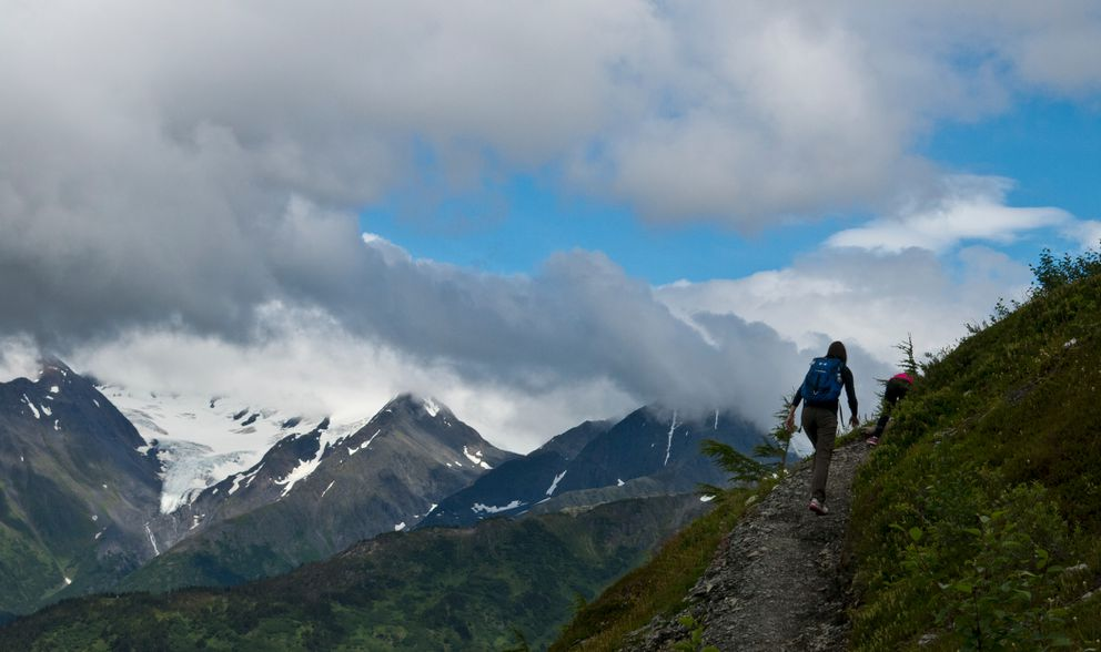 A hiker gains altitude on the North Face Trail on Mount Alyeska, which begins near the Alyeska Resort hotel and climbs about 2,000 feet in 2.2 miles. (Marc Lester / Alaska Dispatch News)