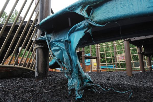 Work has begun removing playground equipment destroyed by fire at Mountain View Elementary School on Tuesday evening. Wednesday, July 11, 2018. (Bill Roth / ADN)