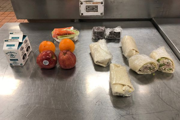 Two options for Ramadan sack meals are pictured in the kitchen of the Anchorage Correctional Complex. The photos show what the Department of Corrections says is a daily portion of food given to an inmate observing Ramadan: Two milk portions, four fruits, two veggie bags, four chicken salad wraps and two pieces of cake (Photo provided by the Department of Corrections)