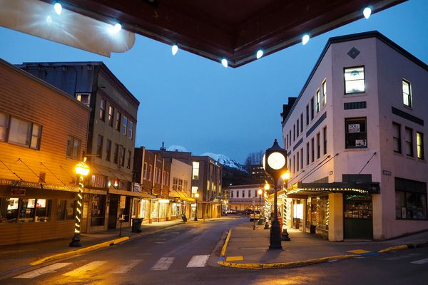 The intersection of Franklin and Front Streets in downtown Juneau are mostly empty as night falls on January 18, 2017. (Marc Lester / Alaska Dispatch News)