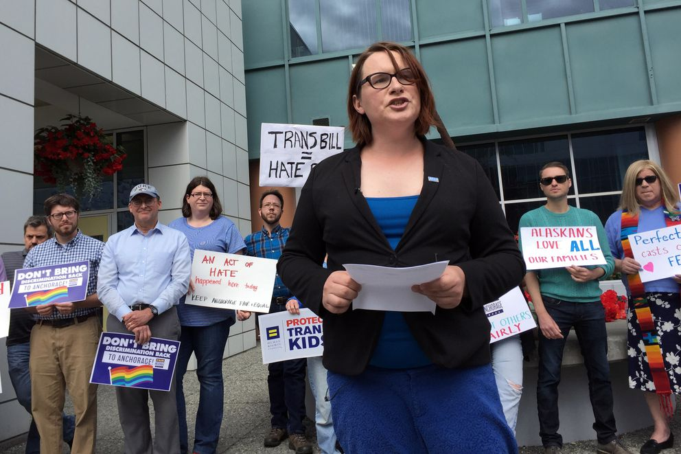 Andrea Zekis, a spokeswoman for the Fair Anchorage campaign, reads a statement in front of City Hall on Thursday, July 20, 2017. Zekis, a transgender woman, said she has lived for many years as a woman but would be required to use the men's restroom under a ballot initiative rolling back local anti-discrimination protections for transgender residents. (Devin Kelly / Alaska Dispatch News)