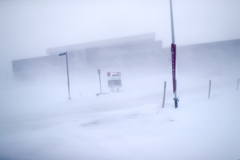 In this Feb. 21, 2019, photo, the entrance to Norton Sound Regional Hospital is seen through a snowstorm in Nome, Alaska. The hospital serves Nome and surrounding villages of the Bering Strait region. (AP Photo/Wong Maye-E)