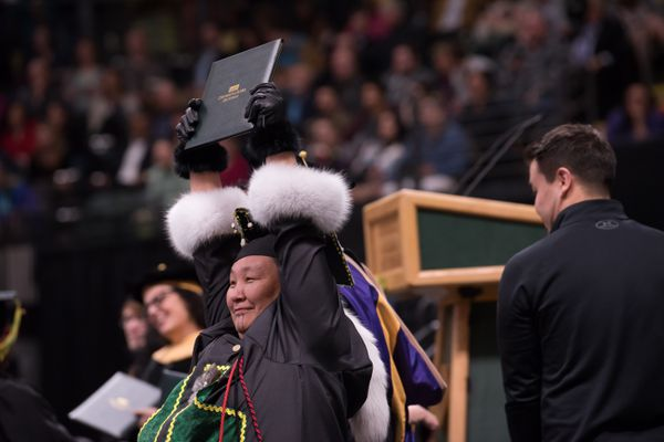 Eva Gregg, BSW Social Work, shows off her degree during UAA's 2019 Spring Commencement at the Alaska Airlines Center. (Photo by James Evans / UAA)