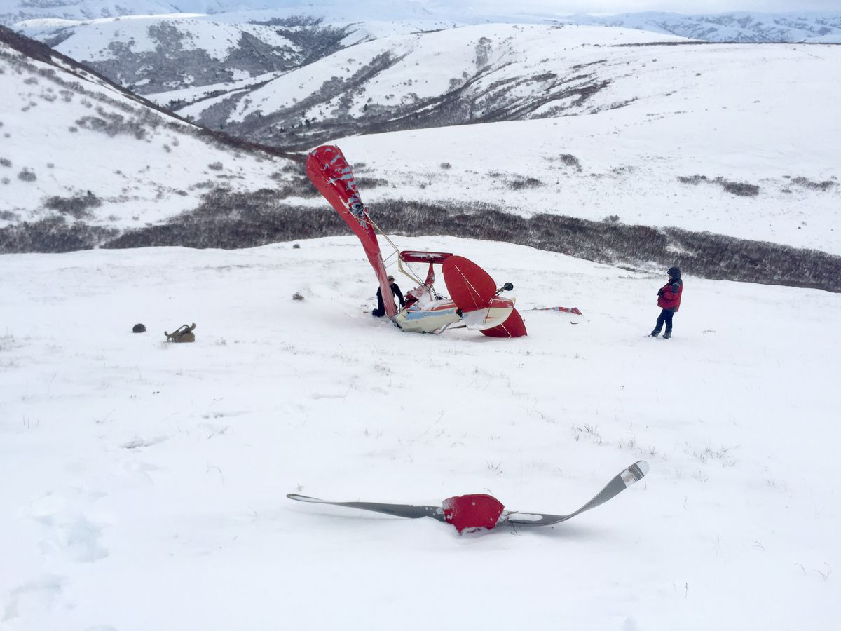 The wreckage of Mark Matter's Piper PA-11 lies on the side of Marvel Dome as investigators examine it. Matter and his wife, Cecilia, died in the Dec. 15 crash. (Alaska State Troopers)