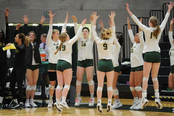 UAA players on the sideline celebrate a point during the Seawolves' 3-0 home victory over Saint Martin's Saints at the Alaska Airlines Center on Thursday, Nov. 21, 2019. (Bill Roth / ADN)