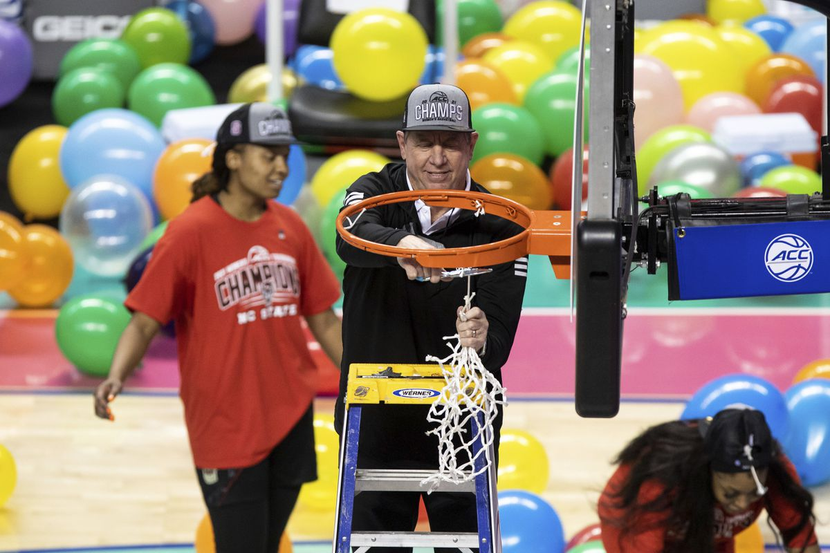 North Carolina State head coach Wes Moore cuts down the net after his team defeated Louisville in the Atlantic Coast Conference championship game in Greensboro, N.C., on Sunday. (AP Photo/Ben McKeown)