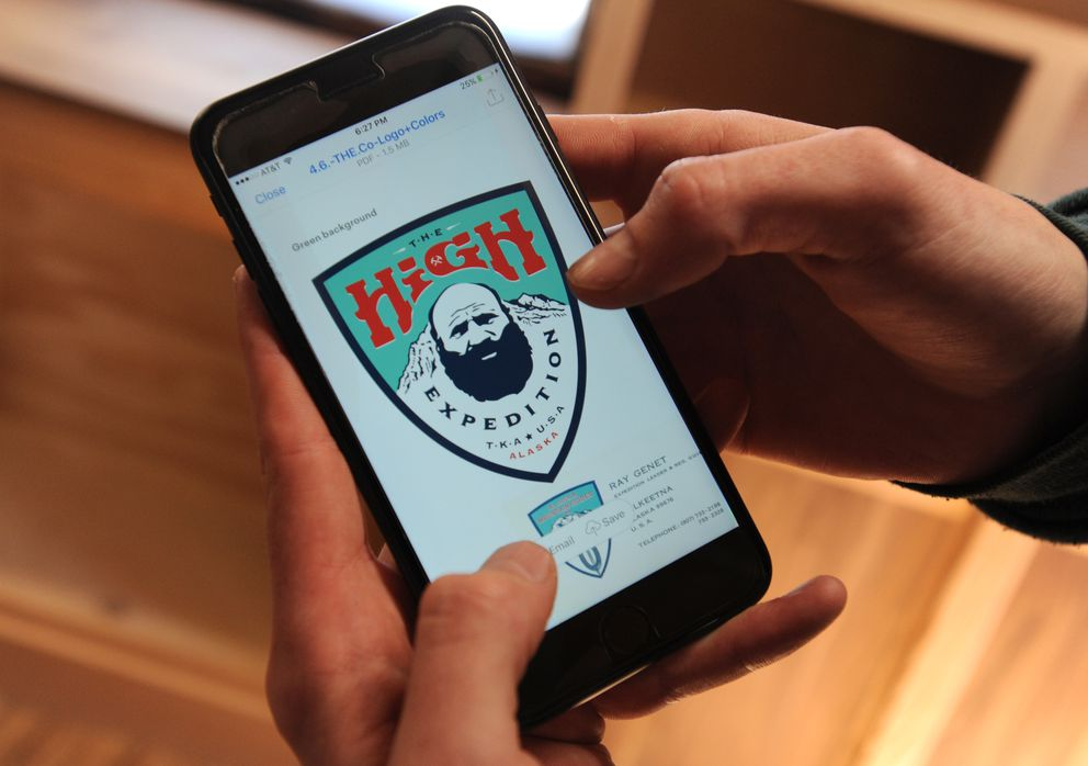 Joe McAneney shows the logo of The High Expedition Co. (Bill Roth / Alaska Dispatch News)