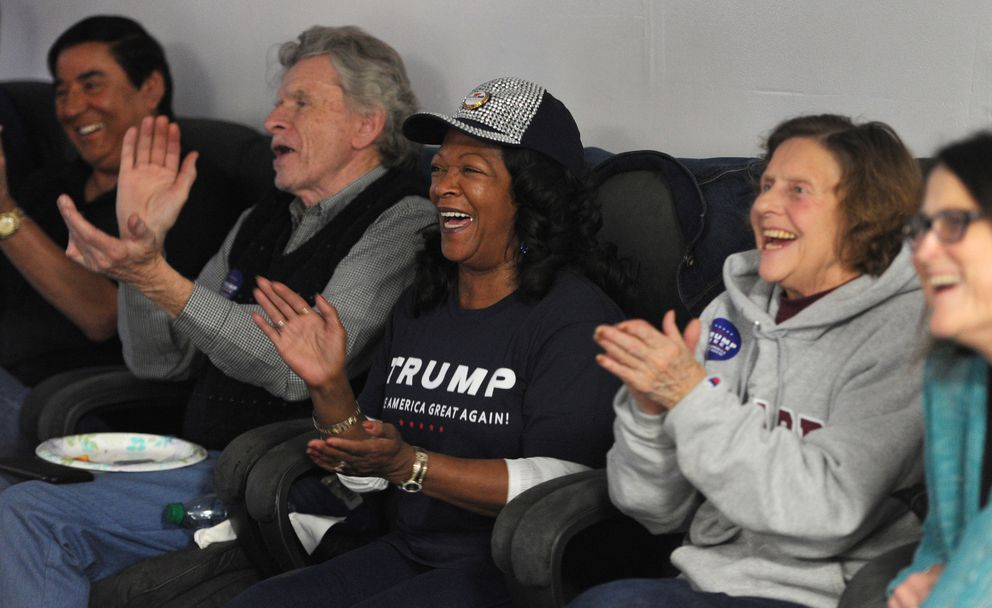 Donald Trump supporters, from left, Jerry Ward, Roger Heiligenthal, Sharon Portch, Mary Heiligenthal, and Ann Stetson react to a statement Donald Trump made about Hillary Clinton during a debate watch party at the Team Trump Alaska Headquarters on Sunday, Oct. 9, 2016. (Bill Roth / Alaska Dispatch News)