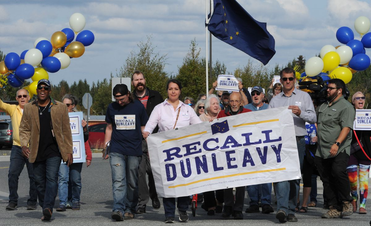 The Recall Dunleavy campaign march towards the State Division of Elections in Anchorage on Thursday, Sept. 5, 2019, where they submitted 49,006 signatures for review and certification. (Bill Roth / ADN)