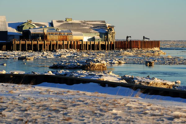Nushagak Bay ice drifts with the tide between the seawall, foreground, and the Peter Pan Seafoods plant on Tuesday, Nov. 29, 2016, in Dillingham. (Erik Hill / Alaska Dispatch News)