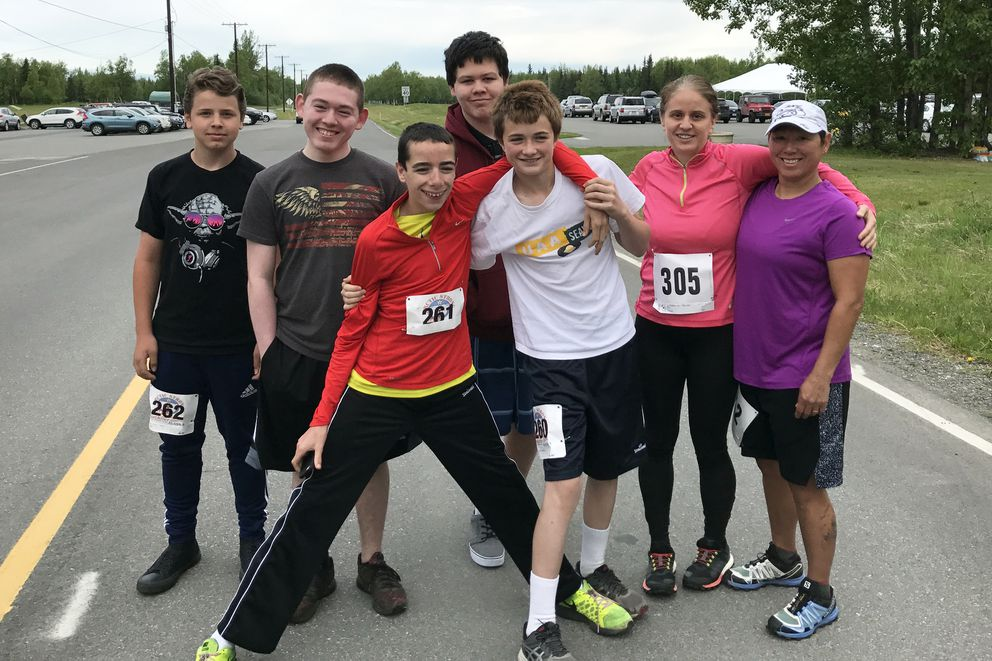 Jack Cooper, center left, stands arm in arm with the author's son, Marty, and family at the Arctic Valley Run on June 3, 2017. (Courtesy Katrina and Rose Garner)
