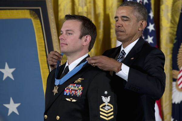 President Barack Obama presents the Medal of Honor to Senior Chief Special Warfare Operator Edward Byers during a ceremony in the East Room of the White House in Washington on Monday.