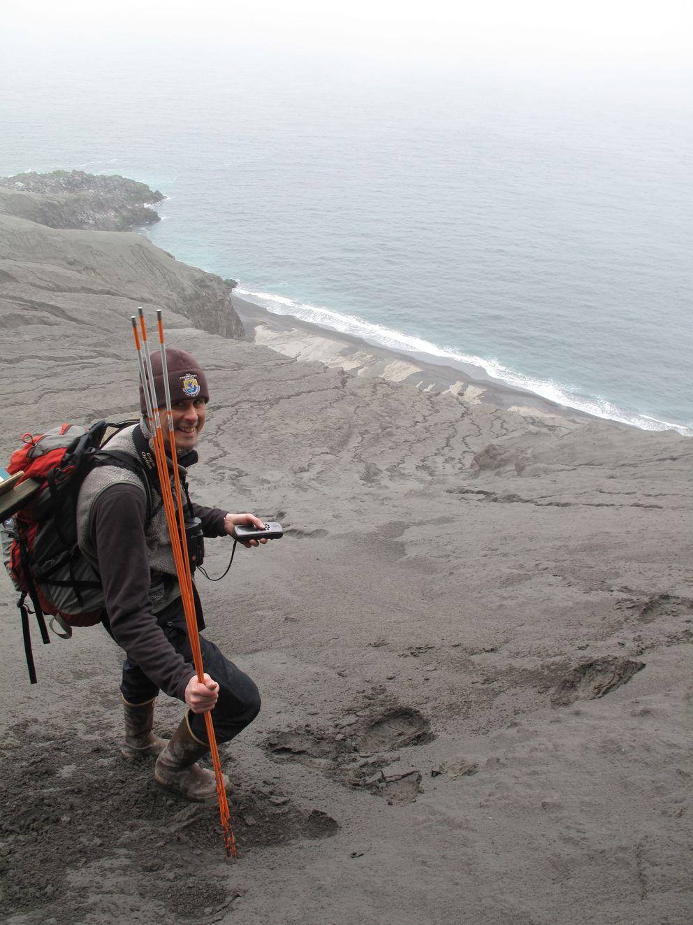 Biologist Jeff Williams on Kasatochi Island one year after its 2008 eruption. (Ned Rozell)