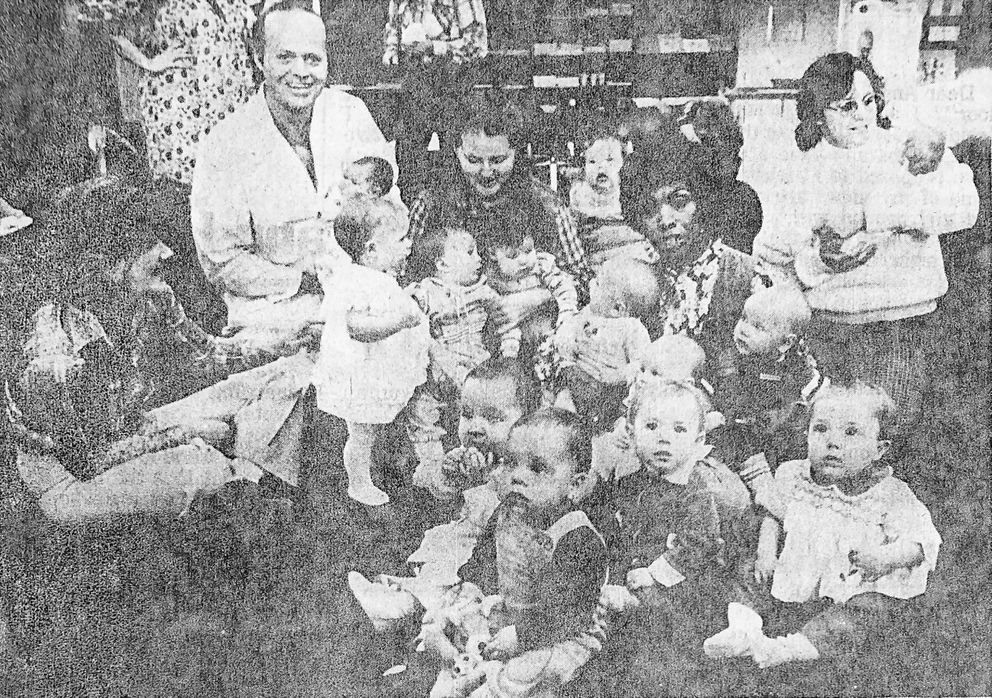 An article from the Nov. 17, 1980 Anchorage Daily News shows midwife Verona Gentry surrounded by babies she helped deliver, including me, wearing overalls in front. (Monte Paulsen / ADN archive 1980)