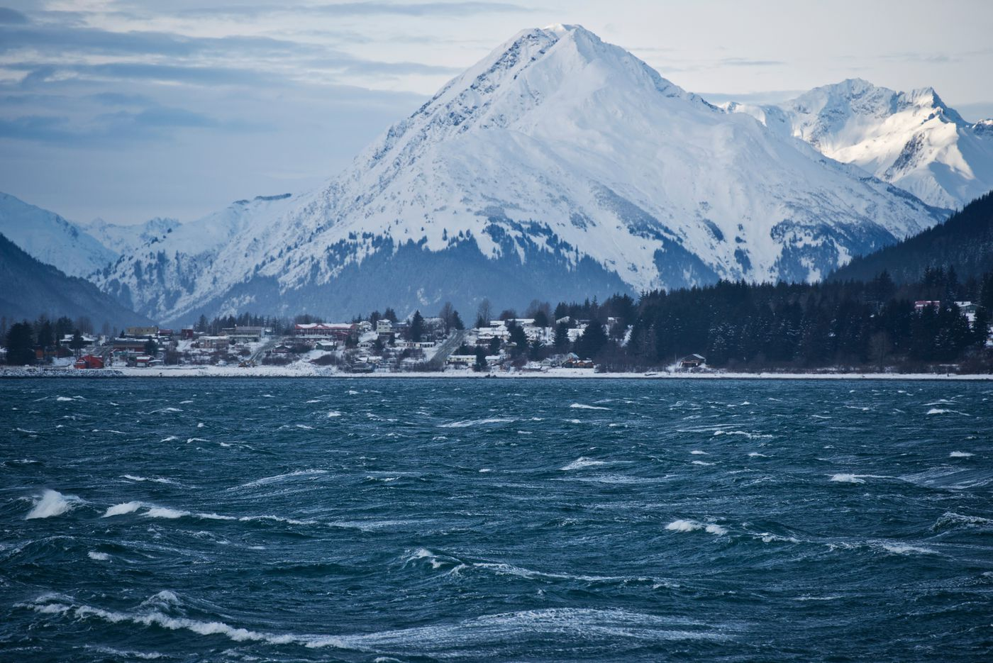 The town of Haines fades from view as a ferry departs for Juneau on January 22, 2017. (Marc Lester / Alaska Dispatch News)