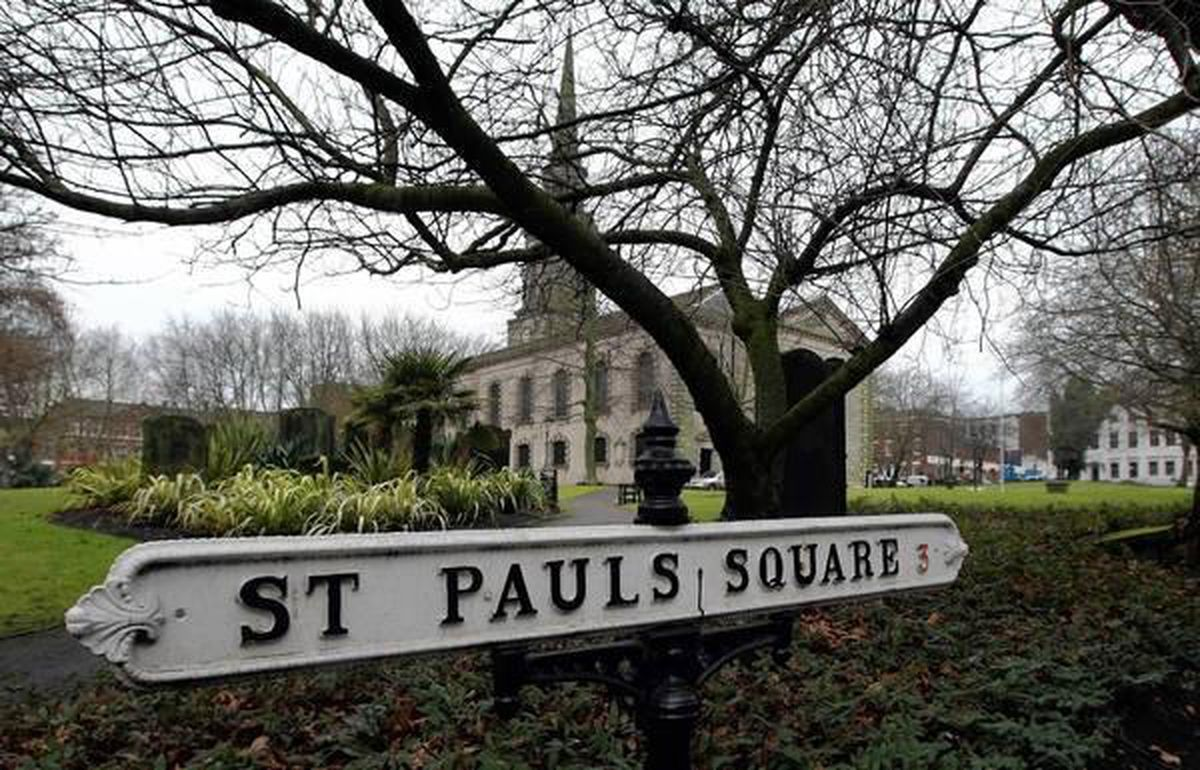 A street sign naming St. Pauls Square without an apostrophe is seen in Birmingham, England. A local government in 2009 decided to stop using apostrophes in its street signs, saying they are confusing, old-fashioned and interfere with modern GPS systems. (David Jones / Associated Press)