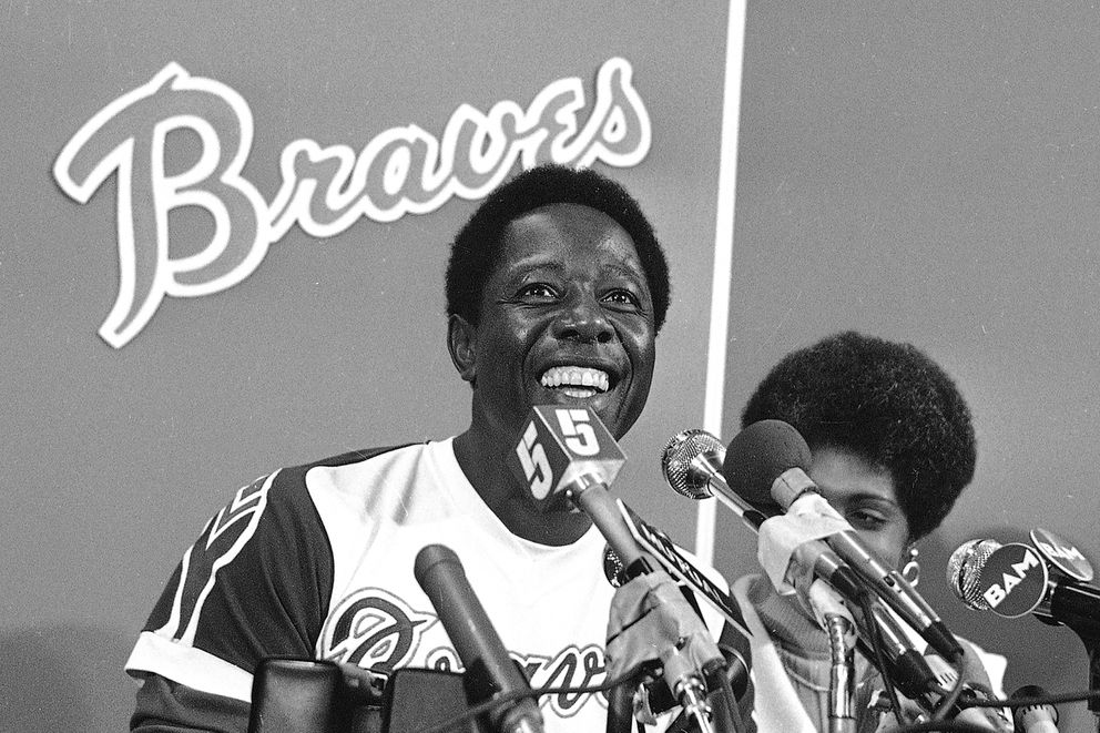 FILE - Atlanta Braves' Hank Aaron smiles during a press conference at Atlanta Stadium, Ga., after the game in which he hit his 715th career home, in this April 8, 1974, file photo. With him is his wife Billye. (AP Photo/File)
