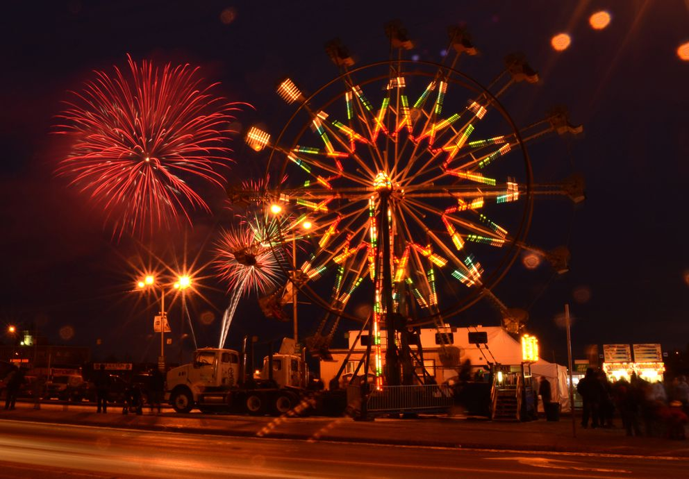 The Rondy fireworks explode in the sky over the Ferris wheel at the Rondy Carnival in downtown Anchorage on the first weekend of the Anchorage Fur Rondy on February 28, 2015. (Bob Hallinen / ADN archive)