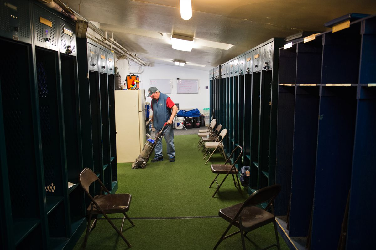 "Bob Barger vacuums the Anchorage Glacier Pilots clubhouse on Monday, a day before the Alaska Baseball League season begins. Barger will begin his 19th season as the broadcast voice of the Glacier Pilots this week. Meeting the players is one of the things that keeps him coming back, he said. ""I love the kids,"" he said. Barger said 17 of the team's 26 college players will be in Anchorage in time for opening day Tuesday, he said. (Marc Lester / ADN)"