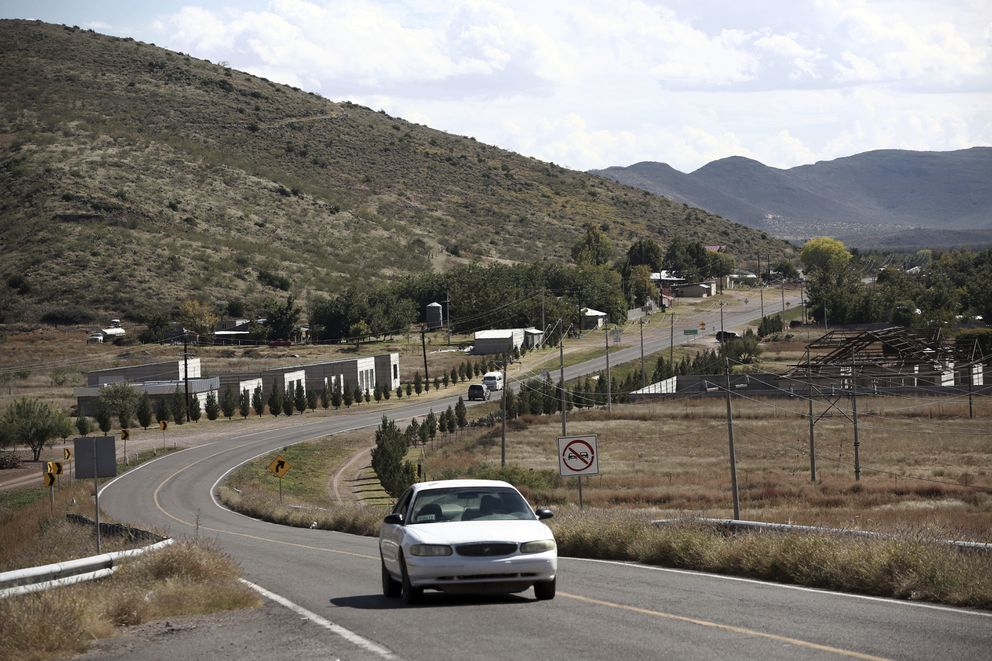 A car passes through Colonia LeBaron, one of many locations where the extended LeBaron family lives in the Galeana municipality of Chihuahua state in northern Mexico, Tuesday, Nov. 5, 2019. (AP Photo/Christian Chavez)