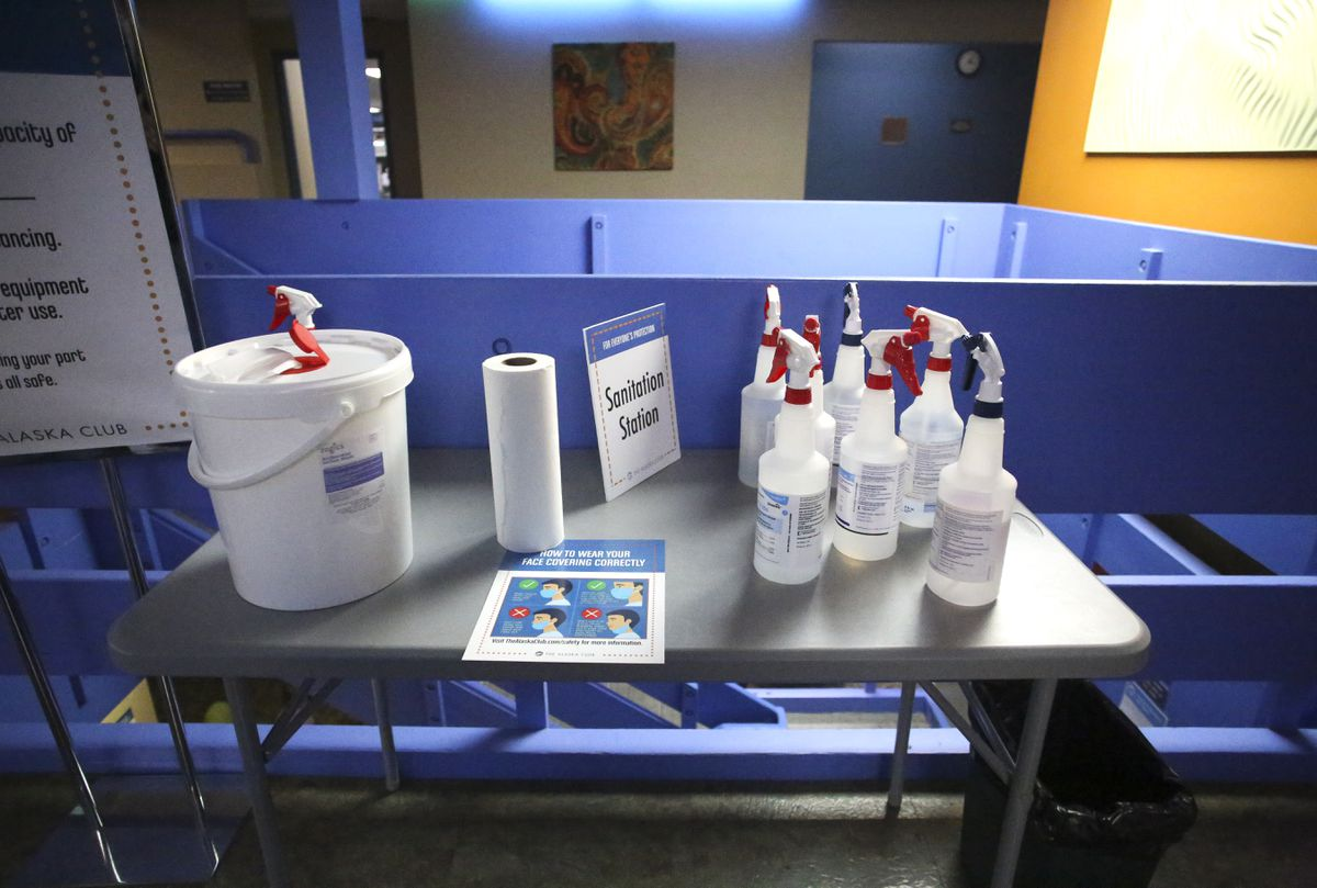 File photo of a sanitizing station set up in a weight room at The Alaska Club East in Anchorage on Sept. 10, 2020. Local health experts say one reason for the unusually mild flu season is likely virus-mitigation efforts that have been put in place to prevent the spread of COVID-19.(Emily Mesner / ADN)