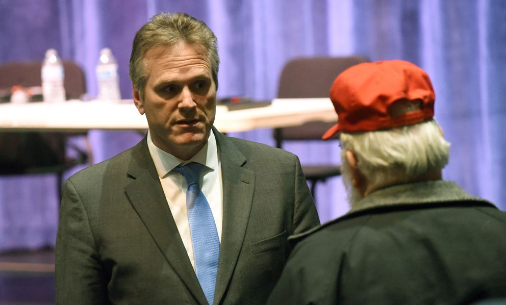 Alaska Gov. Mike Dunleavy talks to a constituent following a town hall meeting at the Steve Primis Auditorium at Chugiak High School on Monday, March 2, 2020 in Chugiak, Alaska. (Matt Tunseth / ADN)