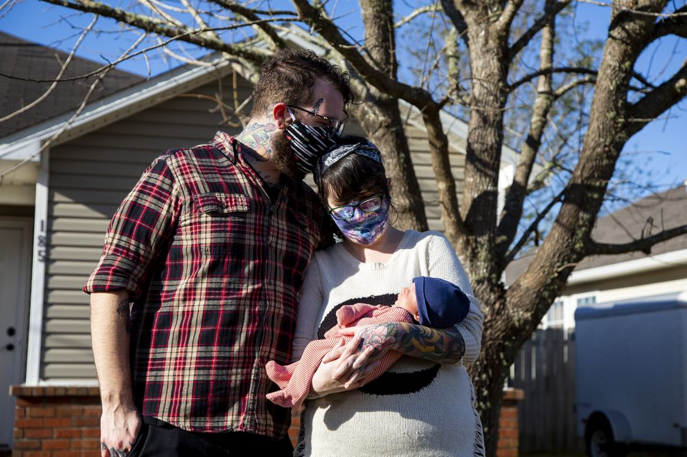 Aaron Walker self-quarantined at home with his wife, Katy Dobson, in the early days of the pandemic. He's back to work at a tattoo shop now, after a couple of months at home. MUST CREDIT: Photo by Meggan Haller for The Washington Post.