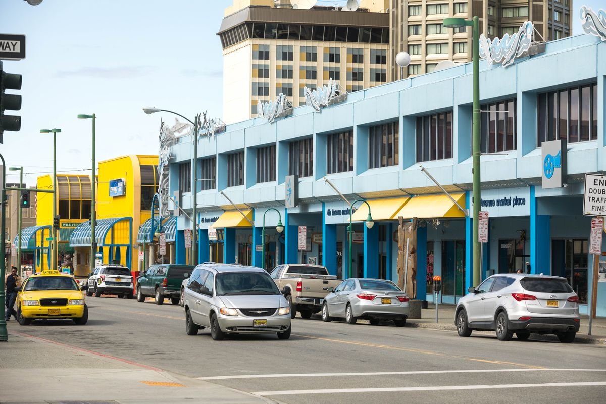 The yellow Sunshine Plaza and the blue 4th Avenue Market Place are the focus of an effort by the Anchorage Downtown Partnership to revitalize the block. (Loren Holmes / ADN)