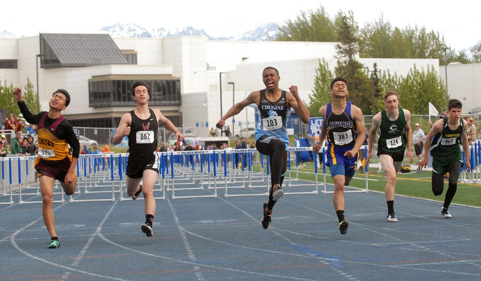 Chugiak's Logan Mathieu (103) exclaims as he wins the Division I boys 110 meter hurdles race at the ASAA/First National Bank Alaska Division I Track and Field Championships at Machetanz Field in Palmer on Saturday, May 25, 2019. (Matt Tunseth / ADN)