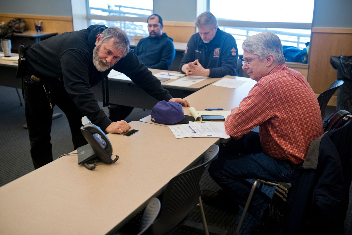 Nome Police Department Chief Mike Heintzelman asks a question during a telephonic meeting of Nome's Local Emergency Planning Commission at the Public Safety Building on March 16, 2020. Nome City Manager Glenn Steckman is at right. (Marc Lester / ADN)
