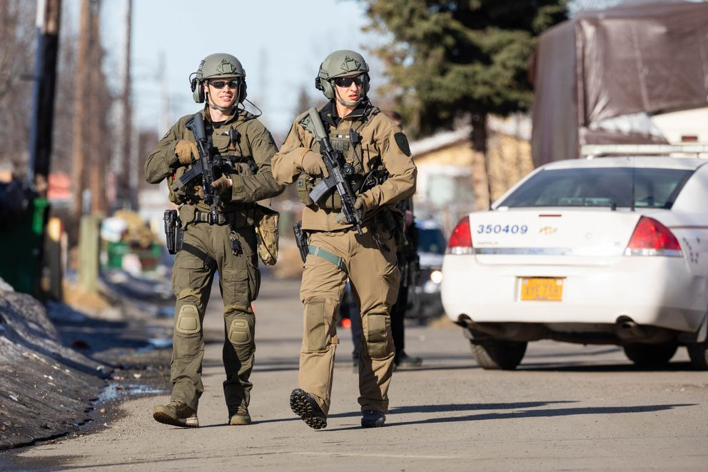 Anchorage police search for suspects in a homicide investigation near the 4200 block of Mountain View Drive on April 12, 2018. SWAT and a police dog unit were on scene to search for two suspects. (Loren Holmes / ADN)